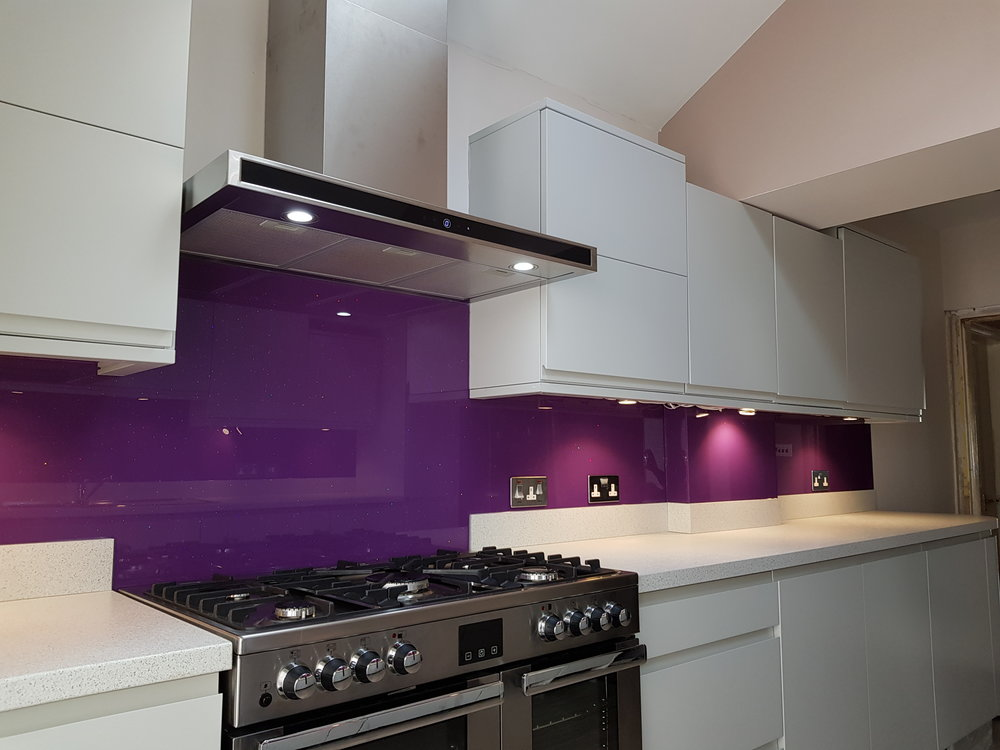 purple glitter on glass applied to kitchen walls