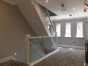glass balustrades with wooden frames on staircase